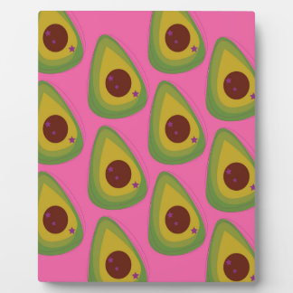 Design avocados on pink plaque
