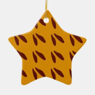 Design beans on gold ceramic ornament