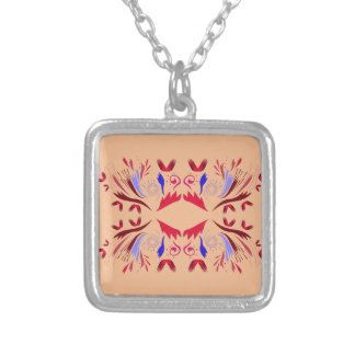 Design elements on beige silver plated necklace