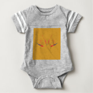 Design elements on gold baby bodysuit