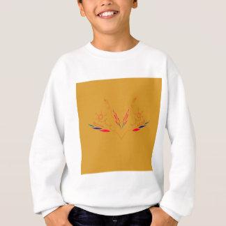 Design elements on gold sweatshirt