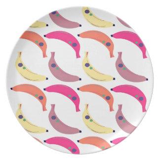 Design exotic bananas on white plate