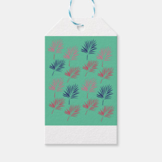 Design exotic leaves on blue gift tags