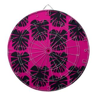 Design exotic leaves on pink dartboard