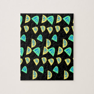 Design lemons on black jigsaw puzzle