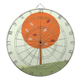 Designers orange tree on green dartboard