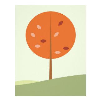 Designers orange tree on green letterhead