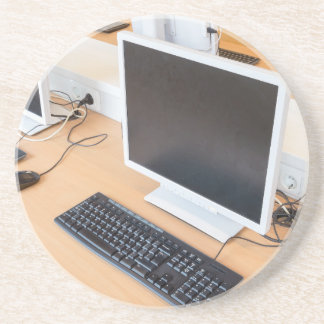 Desktop computer in computer class on school coaster