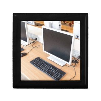 Desktop computer in computer class on school gift box