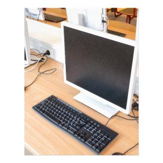 Desktop computer in computer class on school letterhead