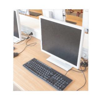 Desktop computer in computer class on school notepad