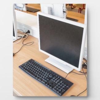 Desktop computer in computer class on school plaque