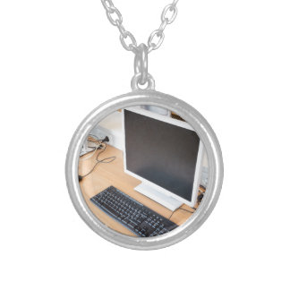 Desktop computer in computer class on school silver plated necklace