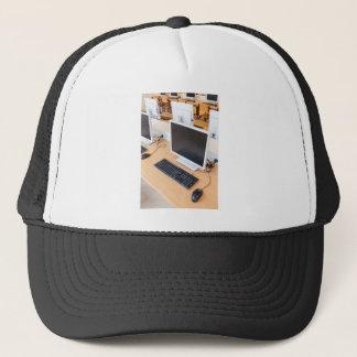 Desktop computer in computer class on school trucker hat