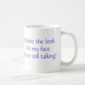 Despite the look on my face coffee mug