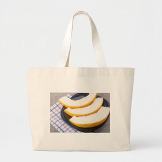 Dessert of sweet yellow melon slices large tote bag