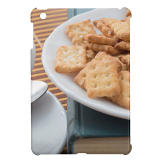 Detail of a cup of tea and a plate of crackers iPad mini cases