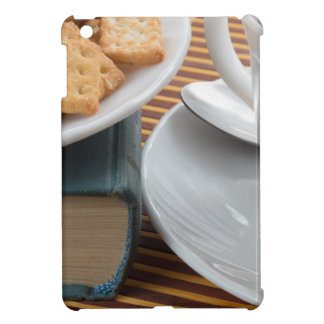 Detail of a cup of tea and a plate of crackers iPad mini cover