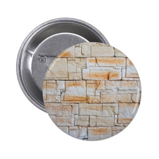 Detail of a decorative wall of limestone tiles 2 inch round button