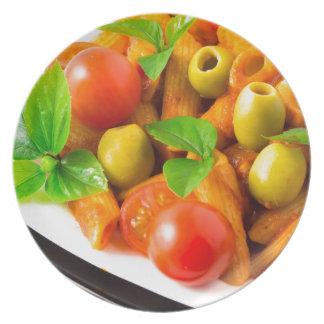 Detail of a plate closeup Italian pasta penne