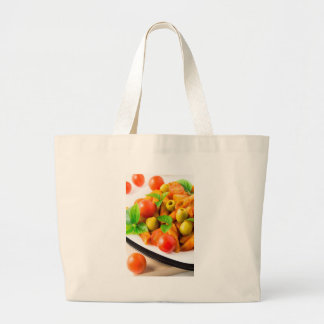 Detail of a plate closeup Italian pasta penne Large Tote Bag