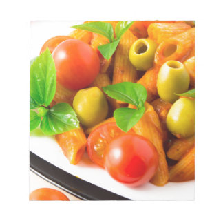 Detail of a plate closeup Italian pasta penne Notepad