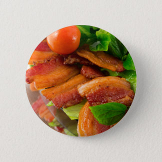 Detail of a plate of fried bacon and cherry tomato 2 inch round button