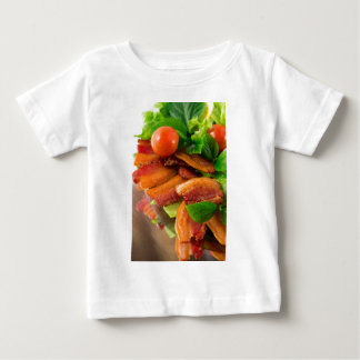 Detail of a plate of fried bacon and cherry tomato baby T-Shirt