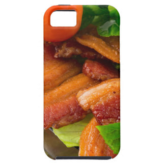 Detail of a plate of fried bacon and cherry tomato case for the iPhone 5
