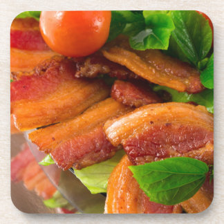 Detail of a plate of fried bacon and cherry tomato coaster