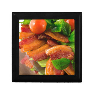 Detail of a plate of fried bacon and cherry tomato gift box