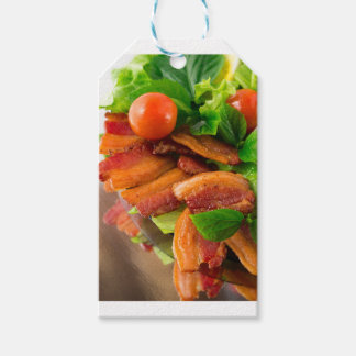 Detail of a plate of fried bacon and cherry tomato gift tags