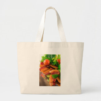 Detail of a plate of fried bacon and cherry tomato large tote bag