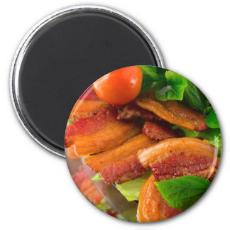 Detail of a plate of fried bacon and cherry tomato magnet