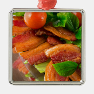 Detail of a plate of fried bacon and cherry tomato metal ornament