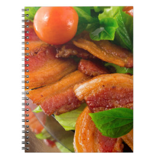 Detail of a plate of fried bacon and cherry tomato notebook