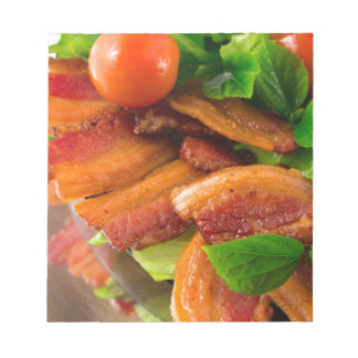 Detail of a plate of fried bacon and cherry tomato notepad