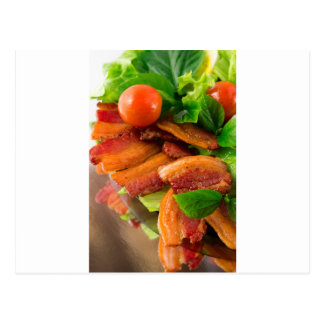 Detail of a plate of fried bacon and cherry tomato postcard