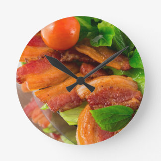 Detail of a plate of fried bacon and cherry tomato round clock