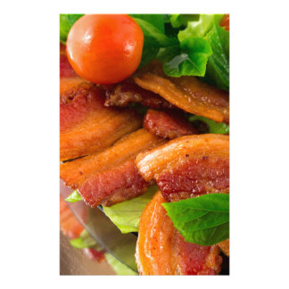 Detail of a plate of fried bacon and cherry tomato stationery