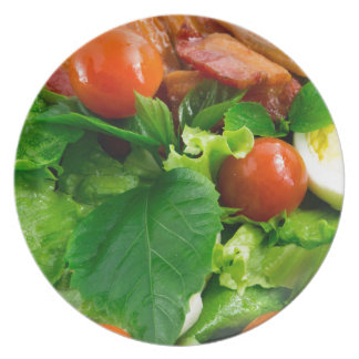 Detail of a plate with cherry tomatoes, herbs