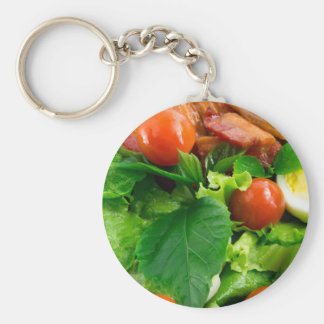 Detail of a plate with cherry tomatoes, herbs basic round button keychain