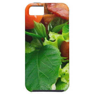Detail of a plate with cherry tomatoes, herbs case for the iPhone 5