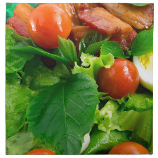Detail of a plate with cherry tomatoes, herbs cloth napkin