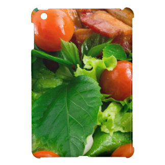Detail of a plate with cherry tomatoes, herbs iPad mini cases