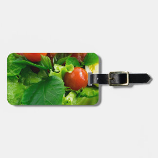 Detail of a plate with cherry tomatoes, herbs luggage tag