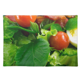 Detail of a plate with cherry tomatoes, herbs placemat