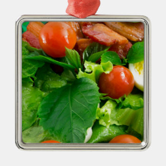 Detail of a plate with cherry tomatoes, herbs Silver-Colored square ornament