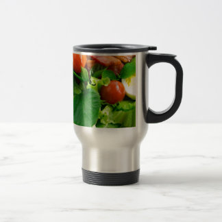 Detail of a plate with cherry tomatoes, herbs travel mug