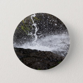 Detail of a small waterfall 2 inch round button